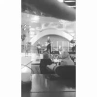 Buck Twenty performing at the Cosmos Bar